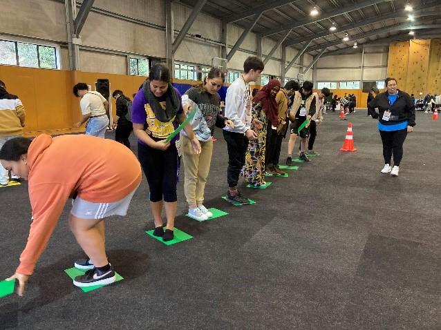 Rangatahi complete a group challenge at PALM Symposium 2021