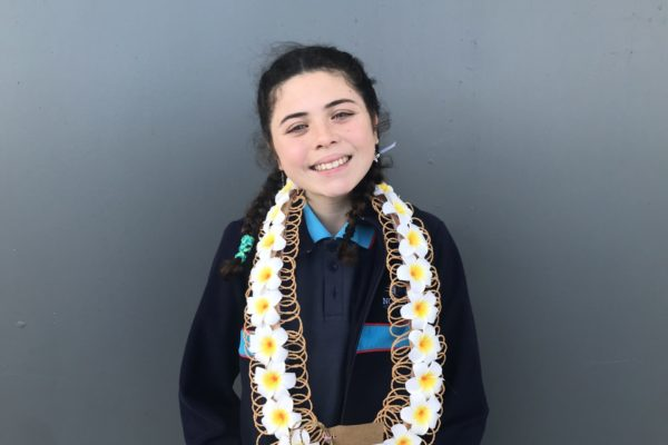 Kyllah Iosua - Rangatahi Winner of the E Tū Whānau Spoken Word Competition at a school event in 2020